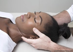 Craniosacral Therapy. female receiving treatment